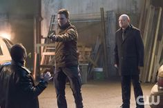 """Arrow -- """"Suicide Squad"""" -- Image AR216b_1214b -- Pictured (L-R): Stephen Amell as Oliver Queen and Eugene Lipinski as Alexei Leonov -- Photo: Jack Rowand/The CW -- � 2014 The CW Network, LLC. All Rights Reserved.pn"""