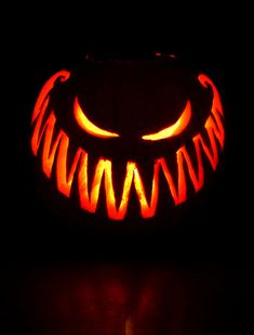 Very scary pumpkin carving of crazy grin. This will scare any trick or treaters away! #pumpkin #carving