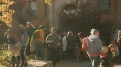 Parents, caregivers and children outside Earl Kitchener public school, Hamilton, October 23, 2014