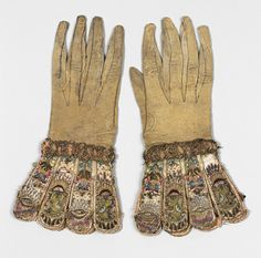 Pair of gloves [English] circa 1620 leather and satin worked with silk and metallic threads and seed beads