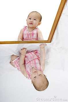cool idea to take pictures of the kids looking into a mirror!!  Cool pose!