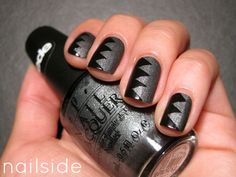 Zigzag  Paint your nails with charcoal glitter (or any color of your choice). After the base completely dries, carefully place a piece of triangle-cut tape on top of the polish. Taking a darker shade like black, paint on top, and then remove the tape to reveal this Gothic-inspired creation.