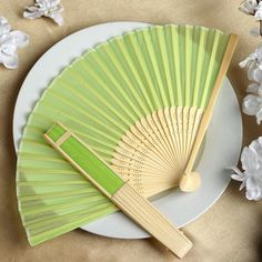 Asian Silk Folding Fans - Apple Green | eFavorMart / Add a classical Asian touch to your wedding, or a special event by presenting your esteemed guests with this special souvenir. Our stylish silk wedding hand fan is intricately handcrafted with a bamboo structure. The framing and spines are crafted from hand-picked bamboo and durably glued with a seamless cut piece of silk to fashion this immaculate magnum opus. Give these swish fans to your respected guests and let them create the lasting…