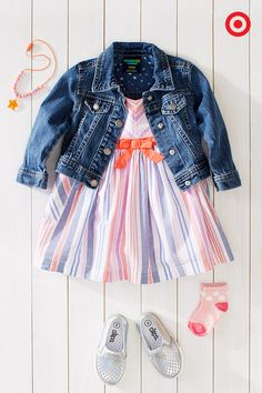 She'll be party-ready from head to toe in this colorful outfit. Add a sweet edge to this cute, striped, bow-trimmed dress with a denim jacket. Accent it with a colorful necklace and matching socks. On-trend metallic shoes will have your little girl stepping out in style.