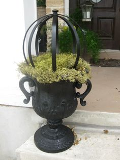 How to Make an Orb - using embroidery hoops, glue and paint. Display in an urn with moss and string lights - via Twelve Oaks Manor