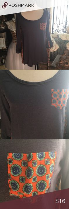 """Anthropologie Top Anthropologie Top  Navy  3/4 sleeve  Round neck line Hi/lo  Orange flowing material alone the back  Light green and blue medallion print  Pocket on front  Super cute casual top  Length in front: 23""""  Length in back: 26""""  Bust: 17.5""""  Please tag me with further questions Anthropologie Tops"""