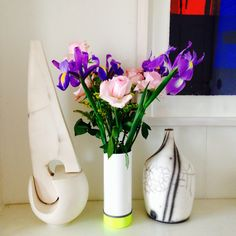 A @taz500 ceramic neon drainpipe vase sits against other ceramics and a Martyn Brewster painting. Read more on #ecomodernstudios in the link.