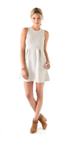 MINI DRESS $60.08 This French terry dress features ribbed banding at the crew neck and cuffs. On-seam hip pockets. Pleating at waist and darts at bodice. Sleeveless.