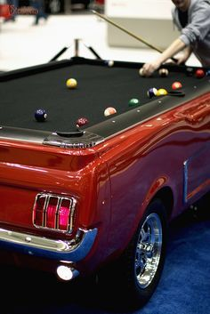 Mustang Pool Table- our future game room needs this ;) with a chandelier made out of beer bottles, no doubt.