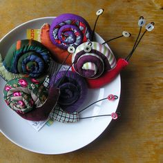 Stuffed snail with brooch.