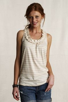 This could be an easy/fun tank to make with an old soft t-shirt or two. Love the subtle ruffle.