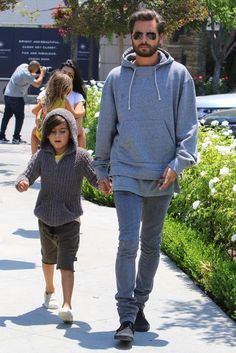Mason Disick wearing Nununu Knit Riding Shorts in Olive Green and Akid Liv Slip-Ons in Tan Pony
