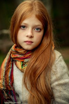 The beautiful young girl in this photograph comes the closest - in terms of facial features and colouring - out of many I've seen to what I envision Nicolette to look like as a child. So, I'm repinning it here if anyone's curious.