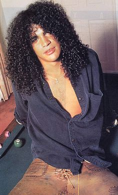 Check out what I found on Bing: http://www.fanpop.com/clubs/guns-n-roses/images/16653325/title/slash-photo