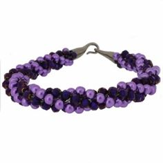 Kumihimo Bracelet - Purple  You must have a go at these bracelets, they are so easy to make and very pretty. They come with full instructions for you to use. I am sure all your friends will be asking you to make one, but don't tell them it only cost £4.99.