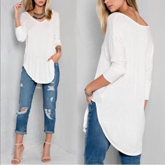 KENYA super soft v neck top - IVORY Basic V-neck loose fit top. 3/4 tapered sleeves with deep side slits. Goes well underneath all of our plaid shirts! Available , h.grey and taupe.   Washing instructions: Cold wash   Fabric 95% Rayon 5% Spandex Made in USA Bellanblue Tops Blouses