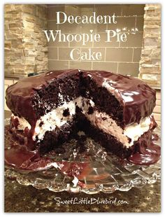 Whoopie Pie Cake!  Decadent chocolate cake with a cream filling drenched in ganache!  Oh so good!