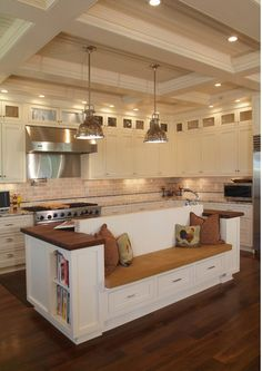 How about this kitchen island/couch?! Relax while you cook!