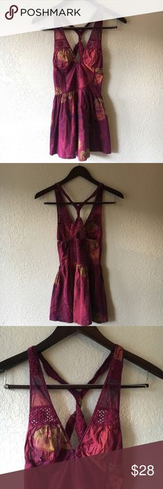 """Free People Peplum Tank FREE PEOPLE Peplum Tank  Deep red racer back peplum tank. With floral print and crochet detail. Eye hook closer in the front and elastic heart touching in the back.  All measurements are approximate:  Bust: 22"""" Length:28"""" Free People Tops Tank Tops"""