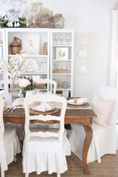 """Thanks so much for stopping by the cottage today! As our renovations wrap up, I am finally able to take some photos and today I am sharing this """"Coastal-Inspired Valentines Table"""" in our dining room! I had so much fun working on this table setting- I used the pretty pink color from the insides of …"""