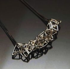 This sterling silver voronoi pendent is light yet structural with a double patina black sterling silver chain. available through our online store. Visit http://ift.tt/1LJWFK2 or email enquiries@studionoesis.com.au for orders.  #jewellery #jewelry #design #geometry #beautiful #silver #sculpture #art #architecture #fashion #fashionary #instagram #instagood #3dprint #3dprinting #prototype #unique #framework #construction #canon #photo #photography #studio #bespoke #unique #instadaily…