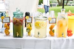 I love this idea with all the different jars + lemonades/ ice tea's (plus) the fruit inside