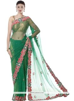 This brilliant array will make you the ultimate classic beauty at the next event you attend. You are sure to make a strong fashion statement with this green net designer saree. This ravishing attire i. Stylish Sarees, Designer Sarees Online, Net Saree, Party Wear Sarees, India Beauty, Classic Beauty, Indian Dresses, Indian Fashion, Blouse Designs