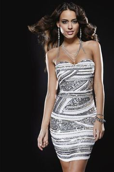 PRIMA Glitz GX1306 Homecoming Cocktail Dress. Stunning strapless beaded and sequin pattern dress. Outer is 100% Silk layered with sequins and beads. Available in Ivory/Silver, Red/Silver, and Black/Si
