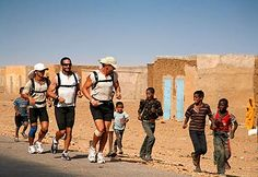 Running the Sahara documentary - by far the most motivating & honest movie out there.  They ran about two MARATHONS per DAY for 100+ days.  talk about mental strength!