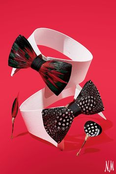 These Brackish bowties and pins add a wildly modern touch to a classic evening look. Wear the black and white Guinea feather accessories to a black-tie gala, or place a lapel pin on a sport coat for everyday.