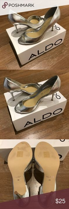 NEW Never Been Worn ALDO Silver Heels Size 36 Here's a beautiful pair of silver ALDO heels in size 36.  They're super stylish and the silver color goes with many outfits.    These are in new, never been worn condition.  The sole is slightly scuffed from trying on indoors.  The heel itself is in perfect condition.  Please check out the pictures.    Smoke free and pet free home. Aldo Shoes Heels