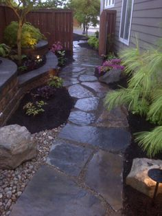 www.boulderfallsinc.com - i am kind of wanting to do a walkway like this along the garage side of the house...it'd be easier to deal with over there! and the garbage cans would roll out easier too.