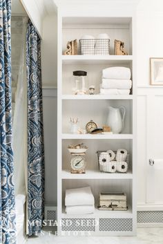 Like the idea of the high shower curtain hanging from a rod installed in the ceiling. Not crazy about the shelves; they take up too much space, and they are dust collectors. Upstairs Bathrooms, Small Bathroom, Bathroom Shelves, Bathroom Ideas, Bathroom Organization, Bathroom Storage, Bathroom Laundry, Bathroom Closet, Large Bathrooms