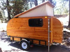Kleine Cabine, Dutch for Little Cabin.  You are looking at a one-of-a-kind Douglas fir camper, pop top with ALL solid wood.  Features are:  50 ft RV cable, 2-6 volt golf cart batteries, 50 Watt solar panel, upper cabinet space with storage under the bed, kitchenette in rear door with two door cabinet, counter top and drawer. There is a small 300 Watt inverter to give you AC for computer, lights, music, and phone charging. Length is 10 ft, width is 4 ft, height is 4.5 ft.  ...