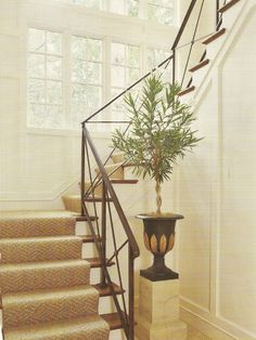 This intriguing staircase features a herringbone sisal carpet.