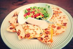 Easiest quesadillas you'll ever make: http://tinyurl.com/j58463g #foodblog #quesadillas #guacamole #recipe #cheddar #jalapeño