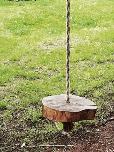 Love the natural form on this Wooden Tree Swing with Natural Jute Rope -  made from oak or maple, and cut at least 3'' thick with an average 12'' diameter