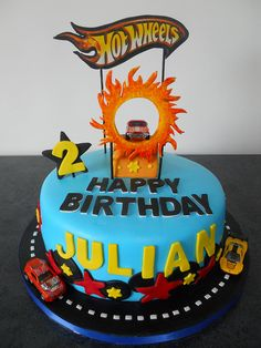 Nothing completes a Hot Wheels themed birthday party like a Hot Wheels cake. If your little racer is into Hot Wheels, then a Hot Wheels b. Hot Wheels Party, Bolo Hot Wheels, Hot Wheels Cake, Festa Hot Wheels, Hot Wheels Birthday, Race Track Cake, Race Car Cakes, 3rd Birthday Cakes, Cars Birthday Parties