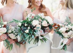 Green, white and blush bridal bouquets at this Southern wedding at venue Belle Meade Plantation. Photo: Cassidy Carson