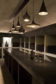 gorgeous idea for wine storage - Tom Dixon - recreate with slate tiles above a wine rack (Ikea Expedit shelving would work) to label each section