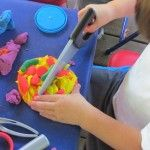 Our play dough is under construction in preschool-construction tool and play dough