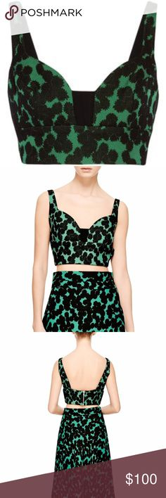 """A.L.C. Morley Floral Crop Bra Top A champion of clean contemporary sportswear underscored by a boyish sensibility, New York-born designer Andrea Lieberman embraces a more feminine mood for spring 2015. Rendered in a bold black and green floral print, this A.L.C bra top captures the retro romance of 60's Italian cinema—infused with an air of modern whimsy. Details - Sweetheart neck - Sleeveless - Back zip closure - Allover pattern - Approx. 14"""" length - Made in USA Fit: this style fits true…"""
