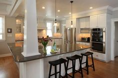 kitchen islands with pillars | Nice white kitchen with big island, beadboard ceiling and subway tile ...