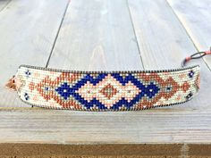 This sparkly, loom woven bracelet with the tribal expanded diamond pattern is created with copper, navy blue, blush, and gray beads. It can be customized to your favorite colors, simply send me a message at checkout with your color preferences. The bracelet is approximately 1 inch