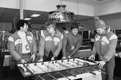 Eruzione, Verchota, Harrington and Suter playing foosball.