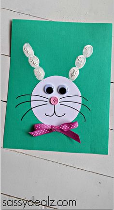 Make a cute bunny craft by using kids fingerprints to make the big ears. It's a great Easter card idea!