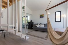 Wohnung in Santa Luzia, Portugal. Charming&Modern loft, with 2mezzanine rooms.  Amazing views, lots of natural light, big window with garden view, it feels like you're outside. You can walk to the beach, ride a Bike, relax on the pool or read in the Village garden.  The Village ha...
