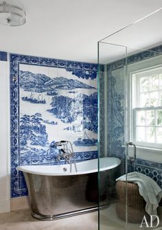 blue and white tile mosaic in Shelter Island bath ~ mural by Chelsea Arts Tile + Stone; tub is by Waterworks, fittings by Lefroy Brooks. photo: Roger Davies.