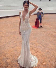 This #JulieVino gown is AMAZING 🙌🏽 it's form fitting, the fabric is beautiful and I love the design! This would be stunning on the…
