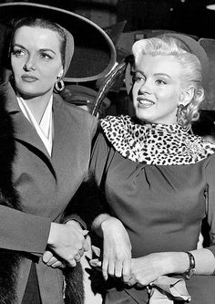 Marilyn and Jane Russell take a break on the set of Gentlemen Prefer Blondes, 1952.